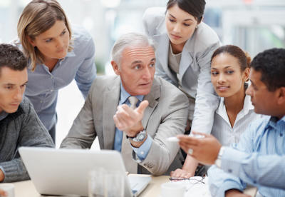 Business meeting - Senior manager discussing work with his colleagues